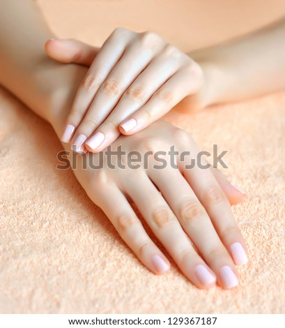 Beautiful woman hands are on a towel