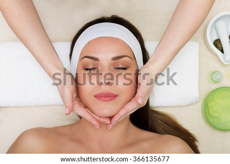 Beautiful woman having a facial massage beauty treatment