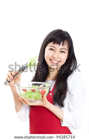 beautiful woman holding glass plate with salad, isolated on white background
