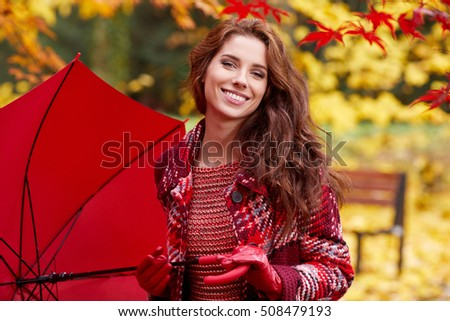 Beautiful woman in autumn park .