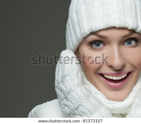 beautiful woman in warm clothing on dark background