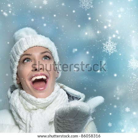 beautiful woman in warm clothing with snow