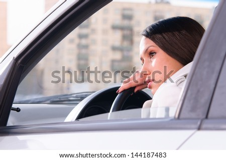 beautiful woman is resting in a car