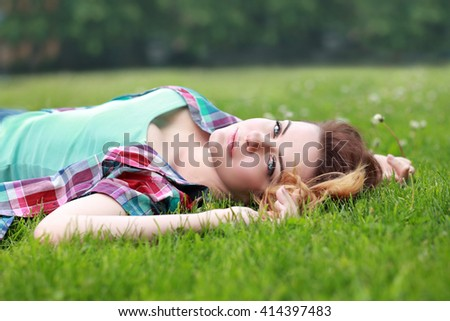 beautiful woman lay on grass outdoor