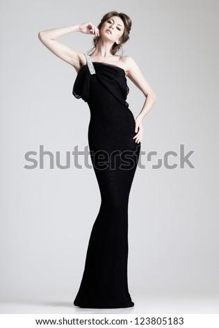 ... woman model posing in elegant dress in the studio - stock photo