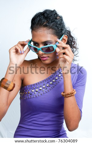 beautiful woman of east indian ancestry sporting sunglasses