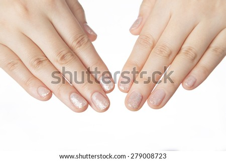 Beautiful woman's nails with manicure on white background