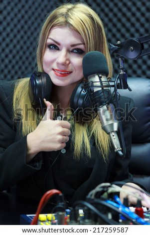 Beautiful Woman Thumbs Up While Recording Sound In Media Studio