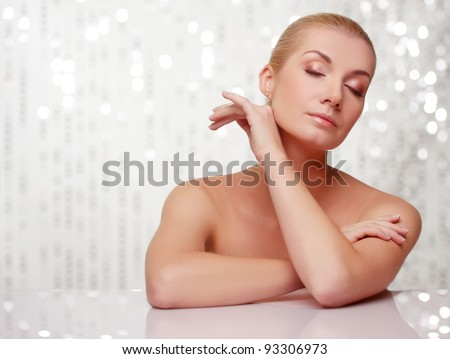 Beautiful woman touching her face.