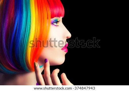 beautiful woman wearing colorful wig and showing colorful nails against black background
