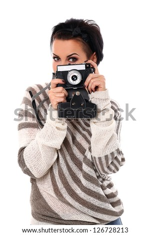 Beautiful woman with camera isolated over white background
