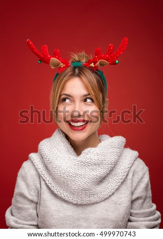 Beautiful woman with christmas funny reindeer ears