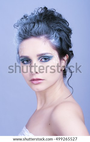 Beautiful woman with creative hairstyle and winter style make-up