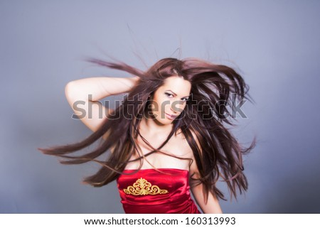 beautiful woman with fluttering hair