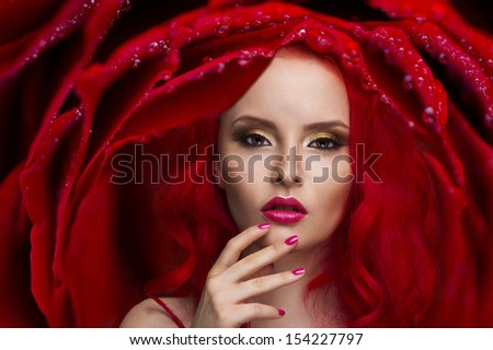 Beautiful Woman with Healthy Red Hair and rose