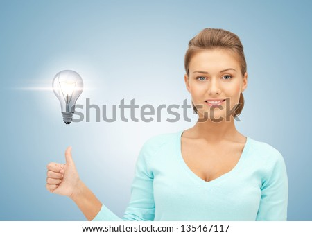 beautiful woman with light bulb showing thumbs up
