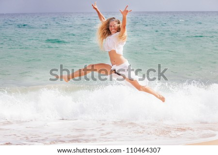 Beautiful Woman with long hair Ecstatic  on the Beach