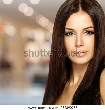 Beautiful woman with long straight hair. Fashion model posing at studio.