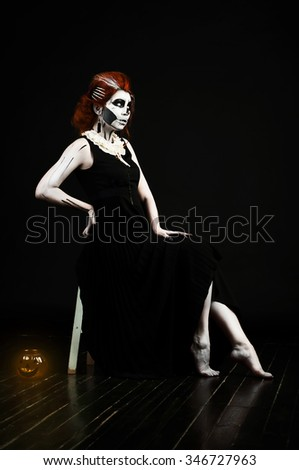 beautiful woman with make-up skull skeleton in halloween, soft focus