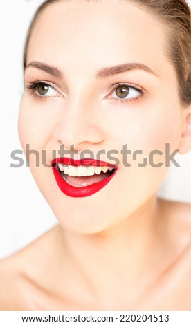 Beautiful woman with perfect smile. Red lips