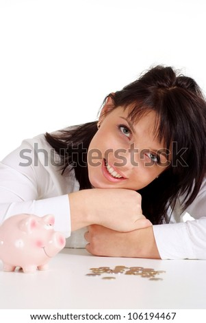 Beautiful woman with piggy bank sitting on a light background