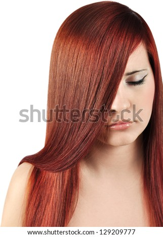 Beautiful woman with straight red hair. Closeup portrait.