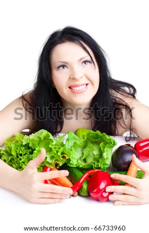 beautiful woman  with vegetables over white background