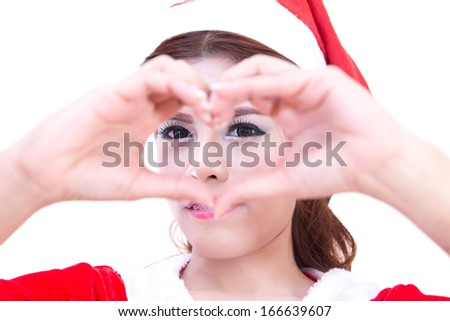 Beautiful women asian hand sign symbol heart in red santa dress. christmas concept