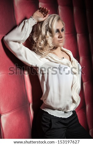 beautiful women in white shirt on red leather background