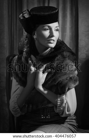 Beautiful young actress in classic 20s interior