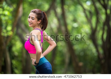 Beautiful young asian woman exercising in the park