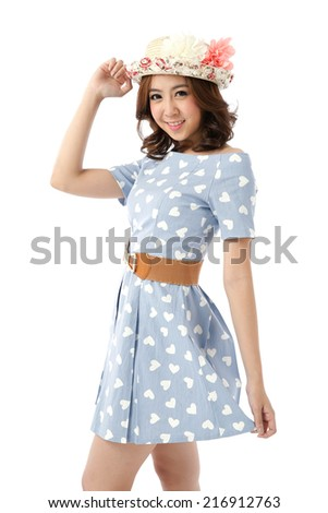 Beautiful young Asian woman posing in Light Blue & White Heart Dress with hat isolated on white background.