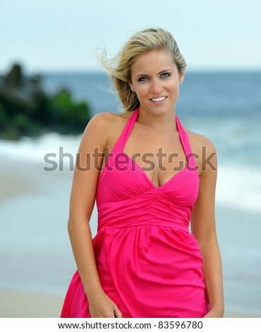 http://thumb10.shutterstock.com/display_pic_with_logo/77601/77601,1314580466,7/stock-photo-beautiful-young-blonde-woman-in-a-red-sun-dress-walking-barefoot-on-the-beach-along-the-waterline-83596780.jpg