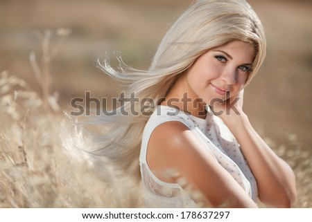 Beautiful young blonde woman in summer nature lifestyle portrait. Skincare and beauty face. Sensual girl with long healthy hair outdoors. series.
