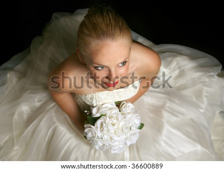 Beautiful Young Bride Sitting Holding Flowers