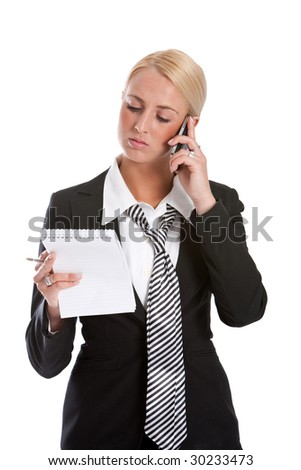 Beautiful young businesswoman checking her notes while on the phone