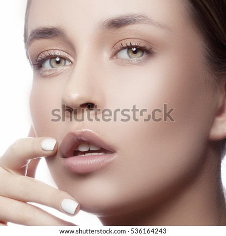 Beautiful young caucasian girl with natural makeup looking at camera. Woman portrait.