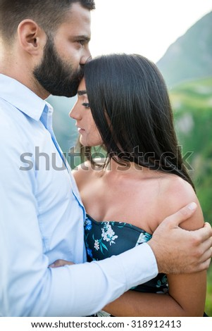 beautiful young couple in love in the mountains