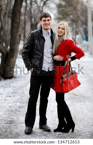 beautiful young couple in stylish clothes