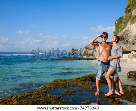 Beautiful young couple on vacation near the ocean