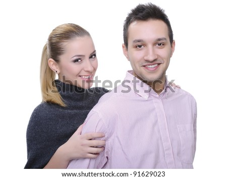 beautiful young couple posing on white background