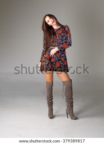 Wonderful Girl Wearing Blouse And Boots Stand Near Wall Stock Photo - Image 22312240
