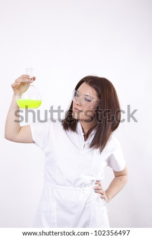 Beautiful young female laboratory technician with test tube in her hand