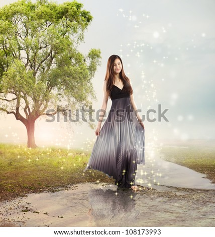 Beautiful Young Girl at a Magical River