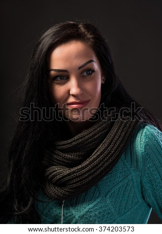 Beautiful young girl on a dark background