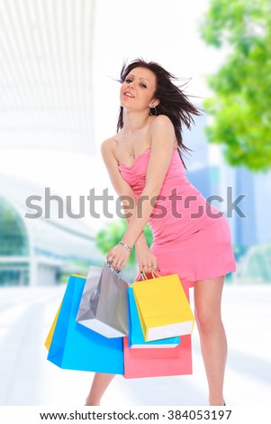 Beautiful young girl shopping in the big city
