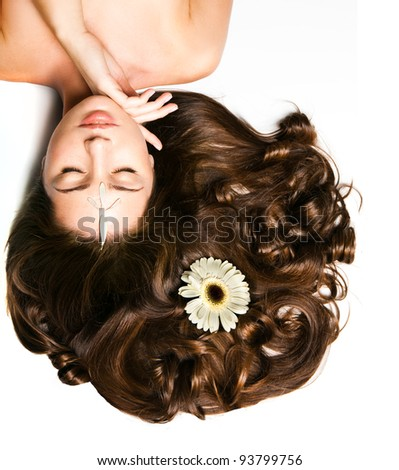 Beautiful young girl with voluminous hair
