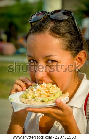 beautiful young happy girl eating a tostada soft taco in guatemala