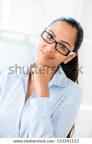 Beautiful young Indian business woman portrait happy smiling