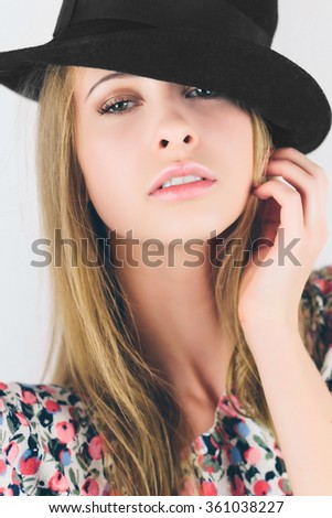 Beautiful young natural smiling woman in hat. Sexy fashion blonde woman with natural lips and natural makeup. Nice slim summer thin white girl with perfect smile. Studio photo white background.